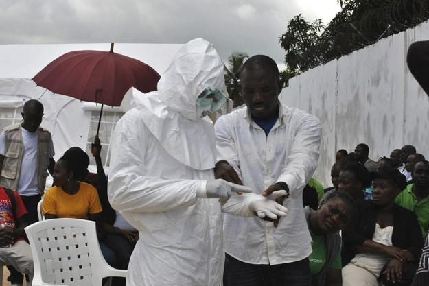 Health care workers in Sierra Leone practice putting on personal protective suits. A lack of basic medical equipment and infection control supplies has resulted in unprecedented viral transmission among health workers, WHO says.