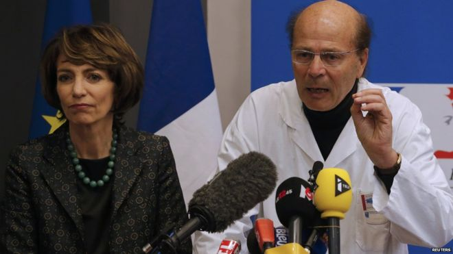 French Health Minister Marisol Touraine, left, and Professor Gilles Edan, the chief neuroscientist at Rennes Hospital, address the media during a press conference about a clinical trial that left one man brain-dead and at least three others with irreversible brain damage.