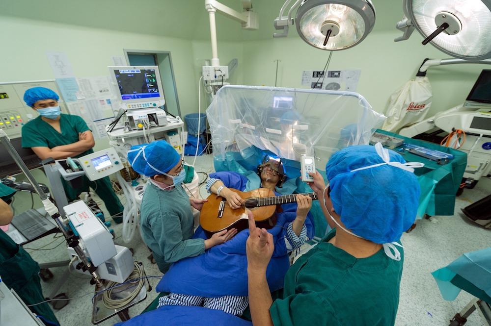 Man plays guitar while having brain surgery