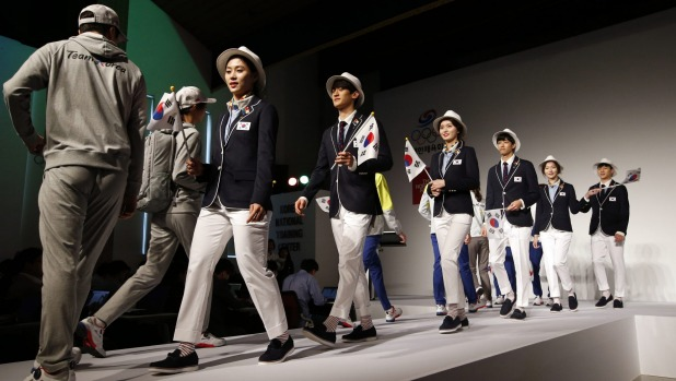 Protection: South Korean athletes model their 2016 Olympic uniform in Seoul. Photo: Lee Jin-man