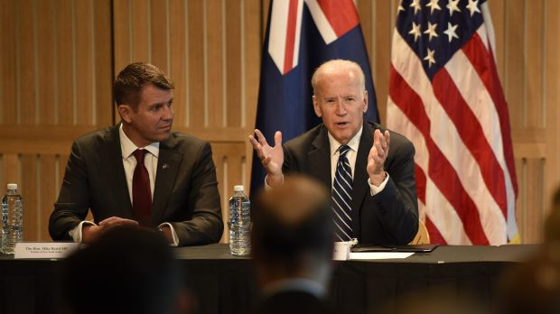 Mr Biden, pictured with Mike Baird, signed a deal for the United States to collaborate with NSW on cancer research.