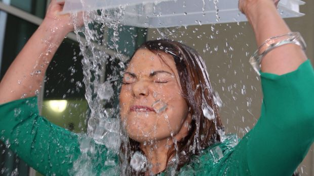 Greens Senator Sarah Hanson-Young completes the ice bucket challenge outside Parliament House in Canberra in August 2014. Photo: Andrew Meares