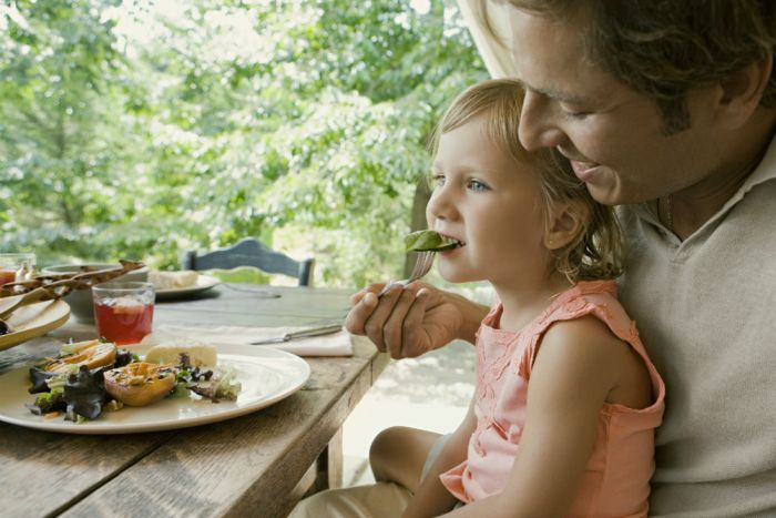 Photo: Regular family meals can help kids develop positive associations with food. (Getty Images: Maria Teijeiro)