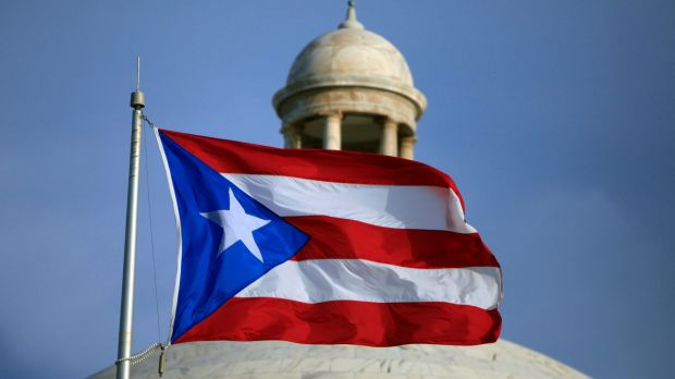 The Puerto Rican flag flies in front of Puerto Rico's Capitol as in San Juan, Puerto Rico. Photo: AP