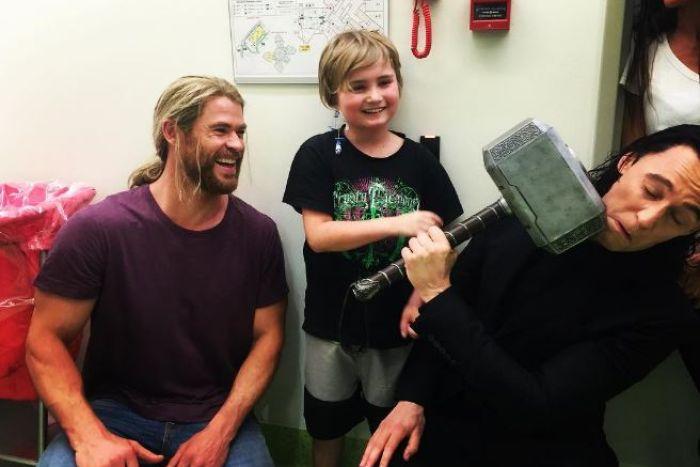 Photo: Chris Hemsworth brought along Thor's trademark hammer Mjolnir and fellow actor Tom Hiddleston to Lady Cilento Children's Hospital. (Instagram: Chris Hemsworth)